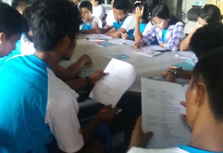 Local youth at a YIC in Magway learn together.
