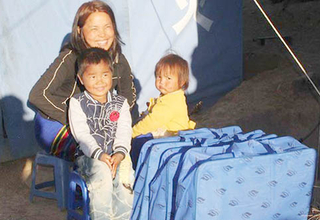 Dawt Hnem and her children live in a tent, which is excruciatingly cold in the winter. Credit: ©IOM