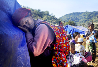 Families, including pregnant women, children, and disabled and elderly people, flee shelling and airstrikes in northern Myanmar's Kachin State.