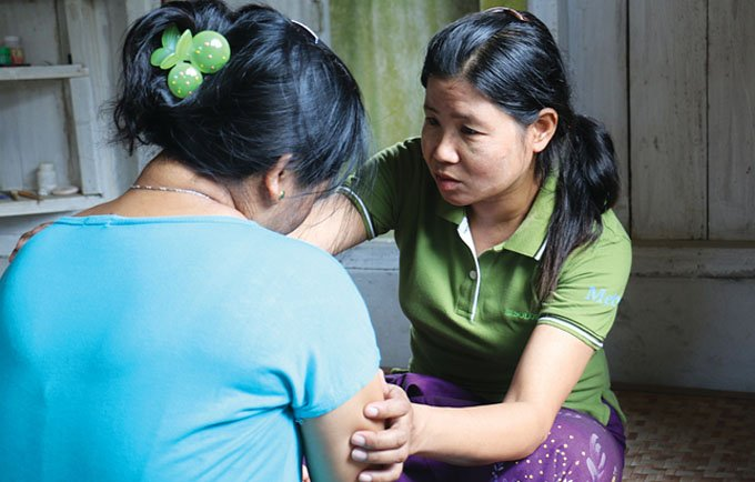 """""""The most difficult part of my job is the repeated cases, where the husband will not change his behaviour, where the wife is not able to leave, and where she is abused again and again"""", says GBV caseworker Lu Bu."""