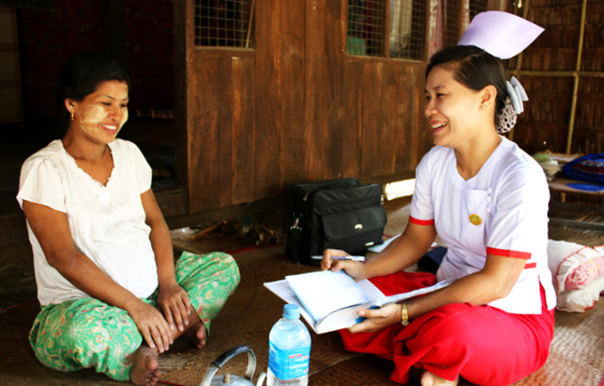 "Midwife Phyu Phyu Win walks from village to village. ""I frequently visit 10 villages so that pregnant women who work all day long can receive regular check-ups and antenatal care without travelling to the clinic. © UNFPA/Nowai Linn"
