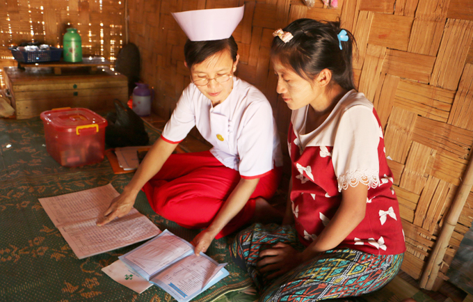 Midwife Nan Mya Phyu discusses family planning with Nan Aye Aye Han in Nam Khoke Village, Shan State, Myanmar.