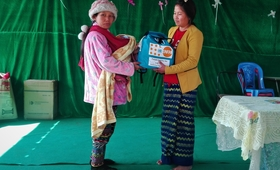 Women and girls who have fled from armed conflict in Mansi in northern Myanmar receive dignity kits at the Man Weing Gyi camp. The UNFPA dignity kits help displaced women maintain their personal hygiene and sense of dignity.