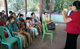 Village women and girls listen intently during Dr Aye's GBV awareness-raising session